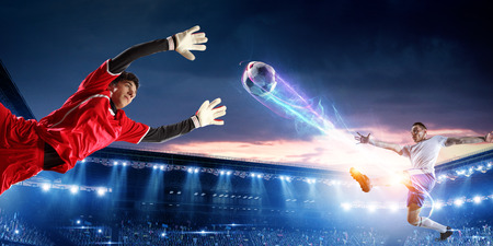 Photo for Soccer players on stadium in action. Mixed media - Royalty Free Image