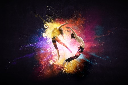 Photo for Young modern ballet dancers in a jump. Mixed media - Royalty Free Image