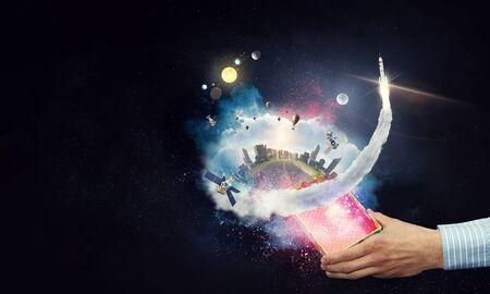 Photo pour Man`s hand holding a small magic paper box, mixed media - image libre de droit