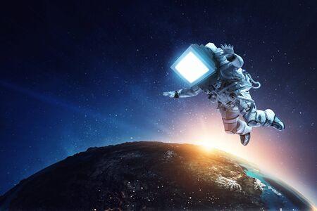 Foto de Astronaut with TV head in space. Mixed media. - Imagen libre de derechos