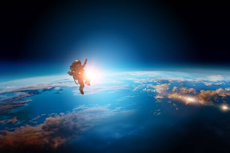 Photo for Spaceman and planet, human in space concept - Royalty Free Image