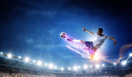 Foto de Soccer player on stadium in action. Mixed media - Imagen libre de derechos