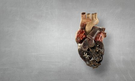 Photo pour Anatomic heart made with gears and mechanic parts - image libre de droit