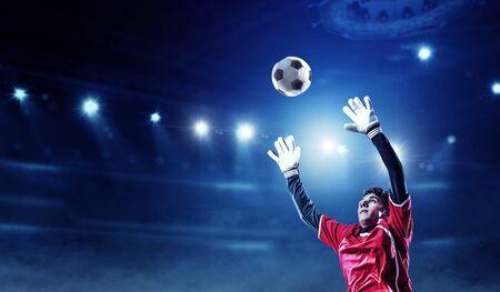 Photo pour Soccer player on stadium in action. Mixed media - image libre de droit