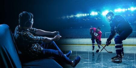 Photo for Young man playing ice hockey game - Royalty Free Image