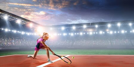 Foto per Young woman in uniform playing tennis in action - Immagine Royalty Free