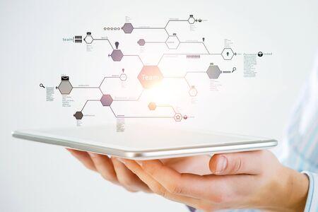 Photo pour Hand of businessman showing tablet pc as concept of connectivity. 3d rendering - image libre de droit