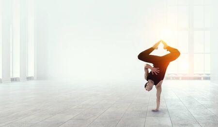 Foto de Dancer guy doing onehand stand. Mixed media - Imagen libre de derechos