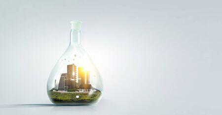 Photo pour Real estate concept with building inside glass flusk. Mixed media - image libre de droit