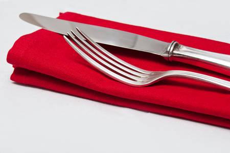 Photo pour Silverware closeup on red napkin - image libre de droit