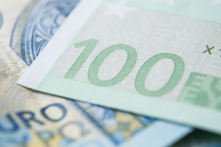 closeup of banknotes of hundred euros money