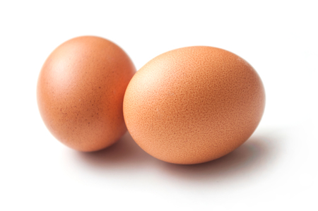 Foto de closeup of two organic eggs on white background - Imagen libre de derechos