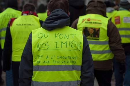 Foto de Mulhouse - France - 29 December 2018 - people protesting in the street against taxes and rising fuel prices - Imagen libre de derechos