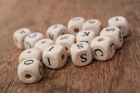 Foto de closeup of wooden letters stack on wooden desk background - Imagen libre de derechos