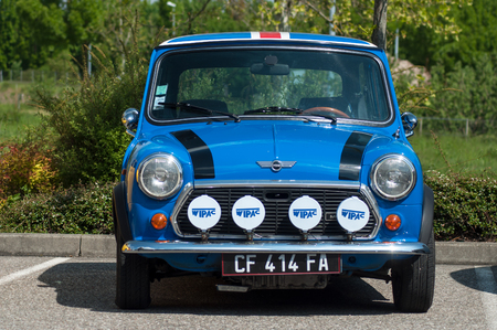 Photo pour Mulhouse - France - 12 May 2019 - Blue Austin mini with rally equipment parked in the street - image libre de droit