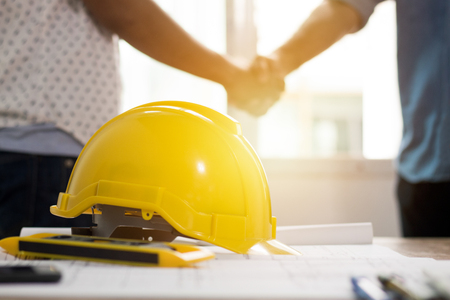 Photo for Teamwork concept, Architecture team shaking hand in building constraction, focus at safty helmet - Royalty Free Image