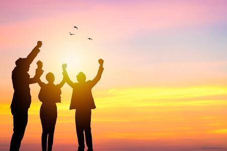 Foto de Team work and succes concept, silhouette business people corporate and win - Imagen libre de derechos