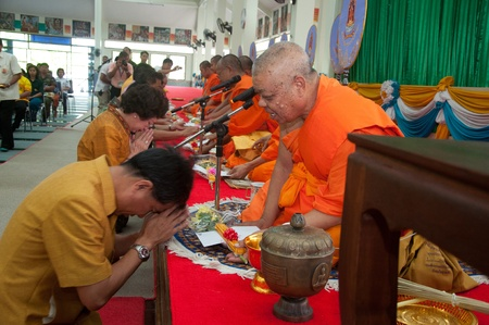 YALA, THAILAND - OCTOBER 22:Mr.Krissada Boonrach pays respect to monk in blessing ceremony for the H.M.K. Bhumibol Adulyadej Birthday ceremony on Oct 22, 2011 at Yala Puttaphum Temple, Thailand
