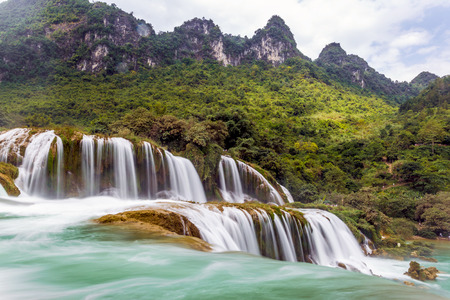 Ban Gioc waterfall in Cao Bang, Viet Nam - The Waterfalls are located in an area of ??mature karst limestone formations Were the original bedrock layers are being eroded