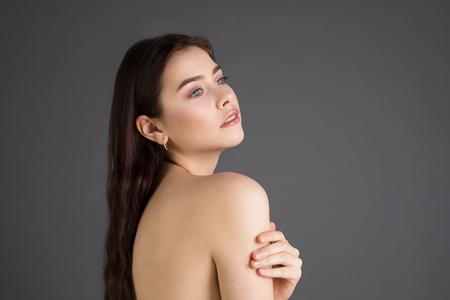 Photo pour Side view portrait of attractive young female with brunette hair - image libre de droit