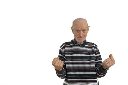 Photo for Waist up portrait of the old man in casual clothes, senior is very happy and excited doing winner gesture with arms raise, looking at the camera, isolated over white background. Celebration concept - Royalty Free Image