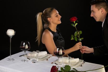 Photo pour Beautiful couple having romantic dinner at restaurant - image libre de droit
