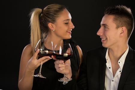 Photo pour Couple having dinner at a restaurant and making a toast - image libre de droit
