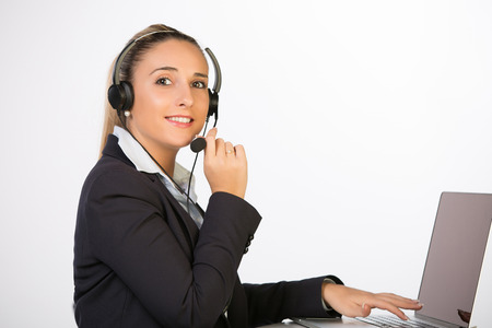 Photo pour Female customer support operator with headset and smiling - image libre de droit