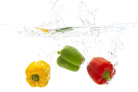 Photo pour freshness vegetable red yellow and green pepper fruit with water splash white background copy space for your text design. - image libre de droit