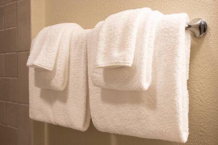 Photo pour Clean white towel on a hanger prepared to use. - image libre de droit