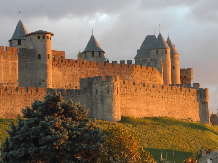 La Cite, Carcassonne, France  View of towers and walls at sunset