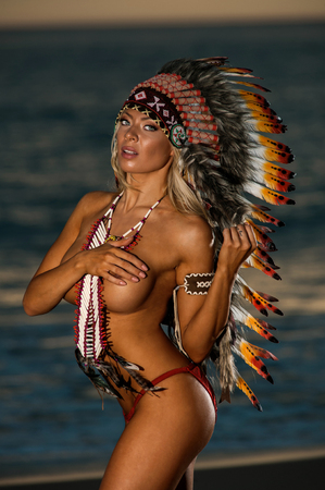 Photo for Sexy woman wearing American Indian war bonnet - Royalty Free Image