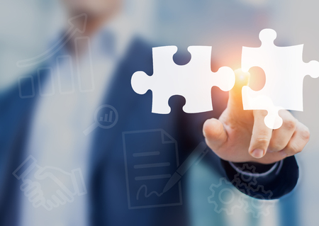 Foto für Mergers and acquisition concept with consultant touching icons of puzzle pieces representing the merging of two companies or joint venture, partnership - Lizenzfreies Bild