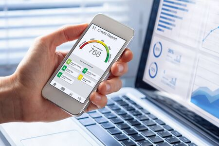 Photo pour Credit Report with Score rating app on smartphone screen showing creditworthiness of a person for loan and mortgage application based on payment history and debt usage, budget management performance - image libre de droit
