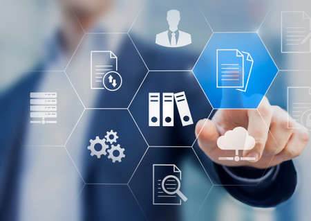 Photo pour Document Management System (DMS) used to store, search and manage review process and users for corporate files and information in enterprise. Concept with business manager pointing to icons. - image libre de droit