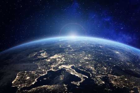 Planet Earth viewed from space with city lights in Europe. World with sunrise. Conceptual image for global business or European communication technology