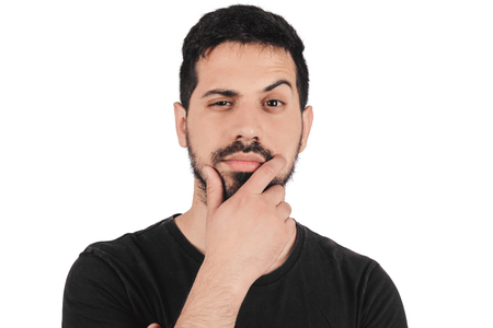 Photo for Portrait of young thinking man with hand near face on studio. - Royalty Free Image
