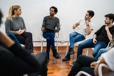 Photo pour Group of multiethnic creative business people working on a project and having a brainstorming meeting. Team work and brainstorming concept. - image libre de droit