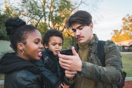 Photo pour Mixed race ethnic family at park. - image libre de droit