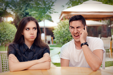 Girl Feeling Bored while her Boyfriend is on The Phone