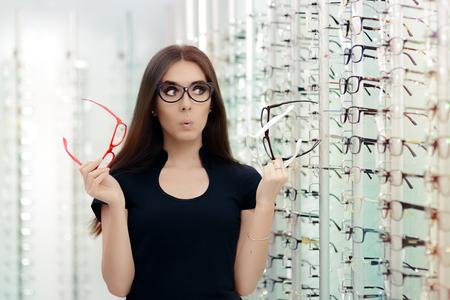 Woman Choosing Eyeglasses Frames in Optical Store