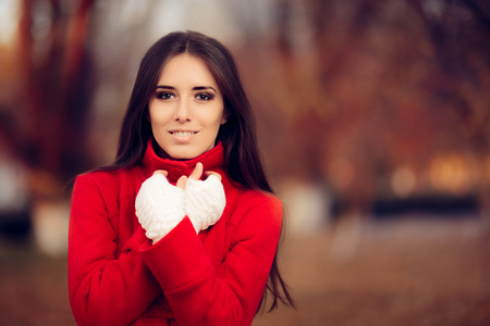 Autumn Woman Wearing Red Coat and Knitted Fingerless Gloves
