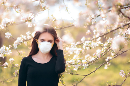 Woman with Respirator Mask Fighting Spring Allergies