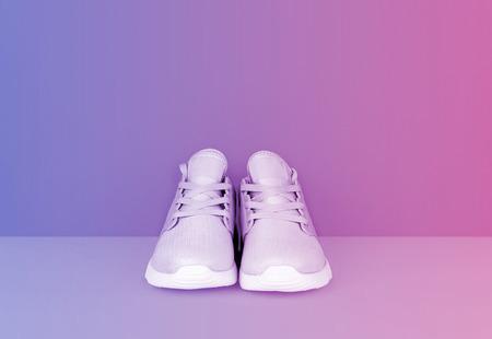 Photo pour Shot of sneakers in vibrant gradient holographic colors. Stylish healthy lifestyle concept. - image libre de droit