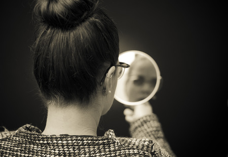 Photo for ego businesswoman looking in the mirror and reflecting - Royalty Free Image