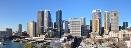 Panorama view of Sydney city CBD and skyline with Circular Quay in the left foreground and the historic Rocks area in the right foreground, Australia