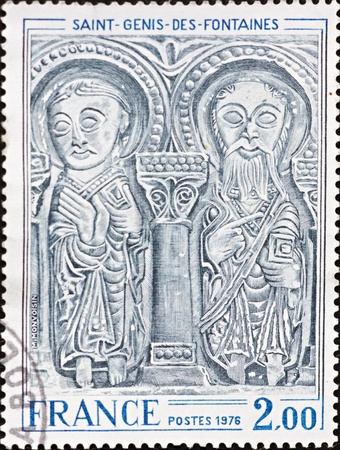 FRANCE - CIRCA 1976: A stamp printed in France,shows an image of the figures that decorate the facade of Saint-Genis-Des-Fontaines,circa 1976.