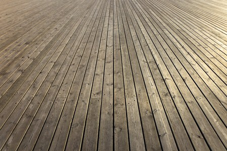 Wooden planks that make up a large pier.