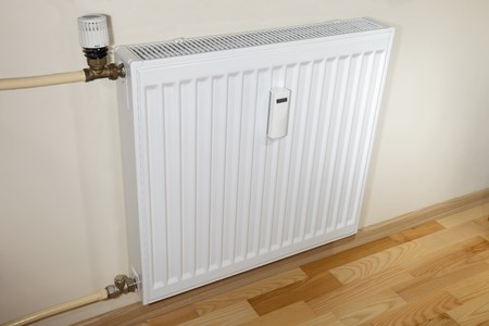 Modern heater/radiator and pipes.