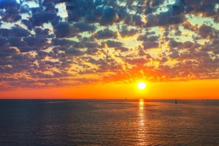 Reflection of the sun at sunrise at sea